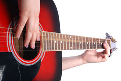 Guitar in girl hand. Red-and-black guitar in girl hand Stock Photography