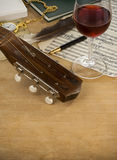 Guitar, glass of wine and note Stock Photo