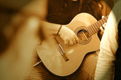 Guitar Guy. Young guy playing his guitar at an outdoor festival Royalty Free Stock Photography