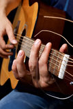 Guitar in hand Royalty Free Stock Photo