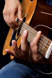 Guitar in hand Royalty Free Stock Images