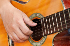 Guitar and hand. Closeup of classical guitar with hand Royalty Free Stock Photo
