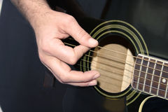 Guitar Hand. Man's hand playing guitar royalty free stock photos