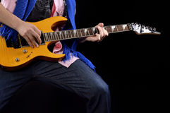 Guitar Hand and Legs. Guitar players hand, legs holding a guitar Stock Images