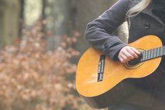 Guitar with hand in nature Stock Image