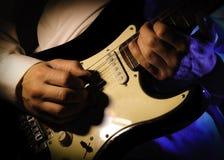Guitar hands. Rock guitar player hand , dramatic lighting Stock Photos