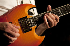 Guitar Hands. Close up on the hands of a guitar player with copy space in the background Stock Images