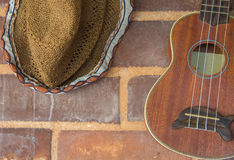 guitar and hat decoration on brick wall royalty free stock photo
