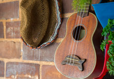 guitar and hat decoration on brick wall Stock Photo