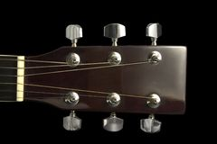 Guitar head. Over black background - front view Stock Images