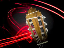 Guitar head and abstract red lights Stock Photos