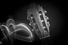 Guitar head. A monochrome close up of guitar head and smoke beside it Royalty Free Stock Photo