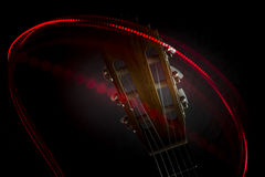 Guitar head and red light. A red light around the headstock of a flamenco guitar Royalty Free Stock Photos