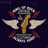 Guitar head and wings rock music emblem. Royalty Free Stock Photos