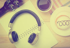 Guitar and headphone on a cafe table stock photography