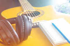 Guitar Headphone notebook for songwriting stock photo