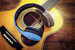 Guitar and headphones. Concept for listening to music or recording studio equipment stock image