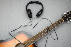 Guitar, headphones, silhouette of a guitarist playing Stock Images