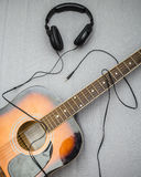 Guitar, headphones, silhouette of a guitarist playing Stock Photography