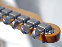 Guitar headstock. With tunes, white васkground, diagonal foreshortening Royalty Free Stock Photography