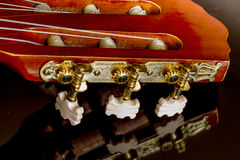 Guitar headstock on black reflecting surface Stock Images