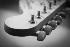 Guitar headstock close-up. Guitar pegs black and white. Retro stylized with shallow depth of field Stock Photos