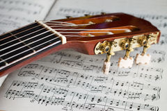 Guitar headstock on music notes Royalty Free Stock Photo