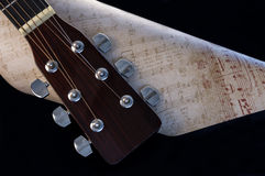 Guitar Headstock and Sheet Music Royalty Free Stock Images