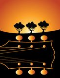 Guitar headstock at sunrise. An artistic, illustrated view of the headstock of a guitar on an abstract background with a bright glow and silhouetted trees to Stock Photo