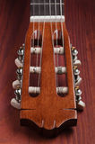 Guitar headstock viewed from low angle on wooden Stock Photo