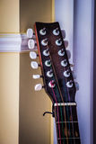 Guitar headstock on wall background Royalty Free Stock Photography