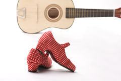 Guitar and heels Stock Photos