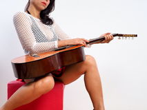 With a guitar on her laps Stock Photo