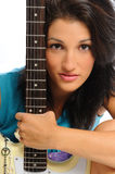 Guitar holding beauty. Attractive young hispanic woman portrait with a guitar on a white background Royalty Free Stock Photos