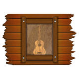 Guitar image on a wooden board in frame uno Stock Photography