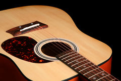 Guitar isolated on a black background Stock Photography