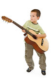 Guitar kid. Little boy playing acoustic guitar - isolated stock image