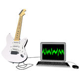 Guitar and laptop Royalty Free Stock Photo