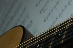 Guitar lesson. Guitar and sheet music stock images