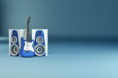 Guitar and louspeakers on blue background Stock Photos