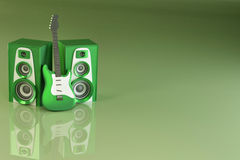 Guitar and louspeakers on green background Stock Photography