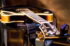 Guitar lying on the stage Royalty Free Stock Images