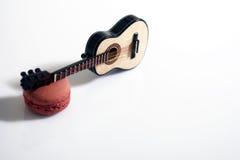 Guitar and macaron Stock Photos