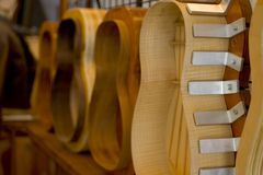 Guitar maker. Guitars in various stages of manufacture Stock Photography