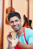 Guitar maker or luthier shows guitar fingerboard Stock Image