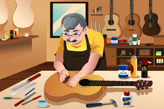 Guitar maker working in his shop Stock Photos