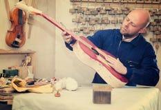 Guitar-maker at workshop Royalty Free Stock Photo