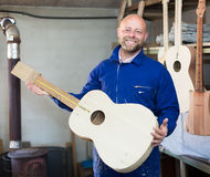Guitar-maker at workshop Stock Image