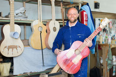 Guitar-maker at workshop Stock Photography
