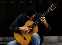 The guitar Man. Man on the streets playing his spanish guitar Stock Photos